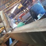 Welders working on complex corner column